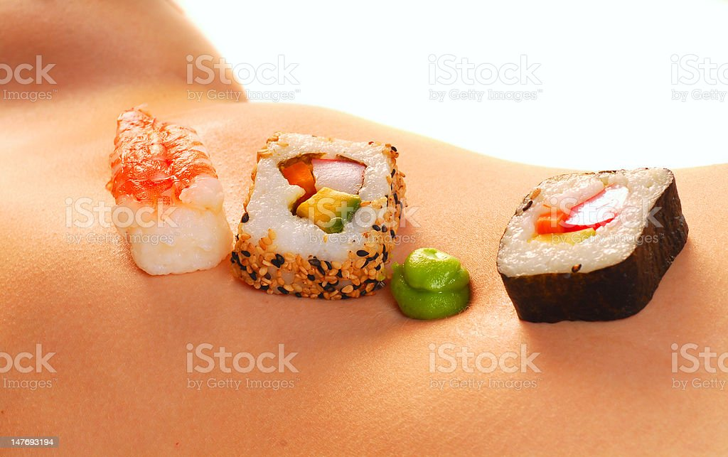 Sushi on a naked woman's stomach royalty-free stock photo