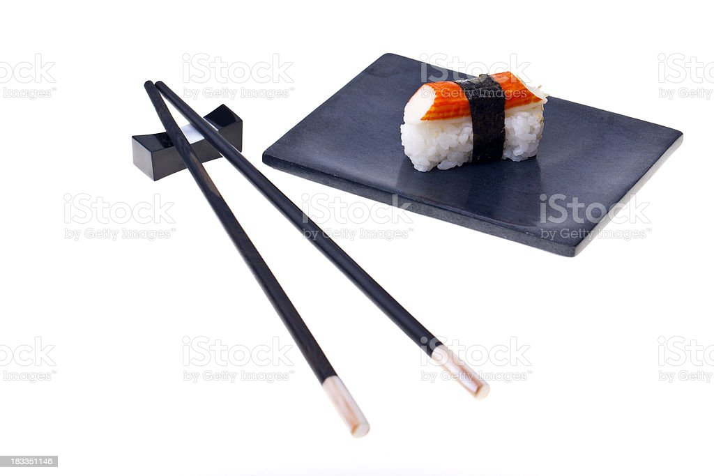 Sushi on a plate with chopsticks stock photo