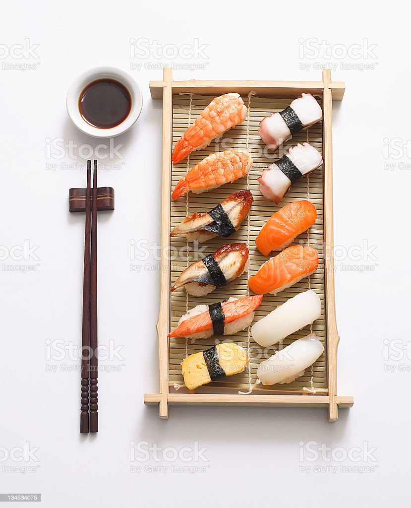 Sushi on bamboo palate with chopsticks and soy sauce royalty-free stock photo