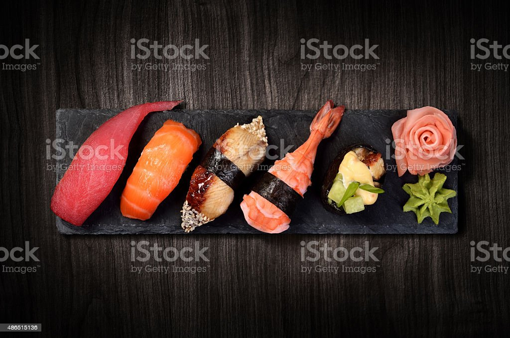 Sushi on black stone plate stock photo