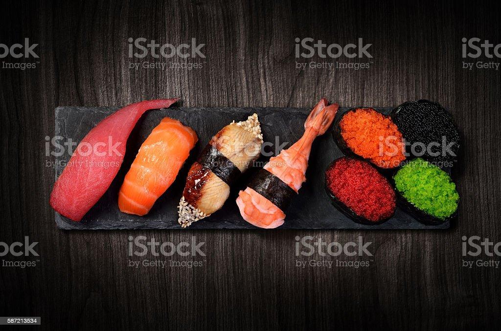 Sushi on black stone plate stock photo