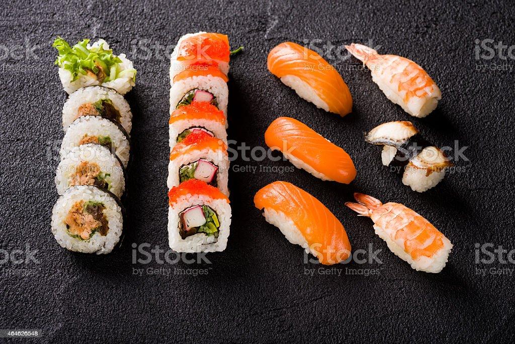 Sushi on black stone table stock photo