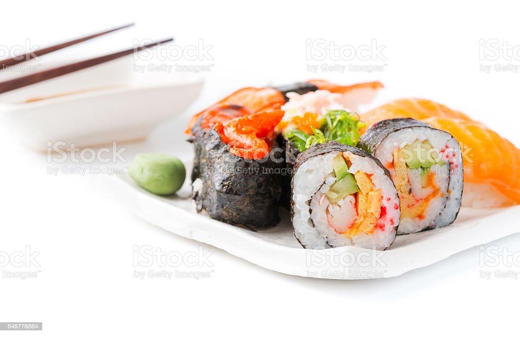 sushi on white dish isolated stock photo