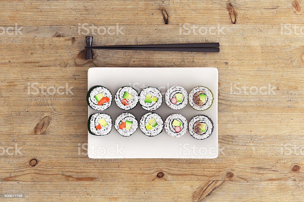 Sushi plate top view with sticks o stock photo