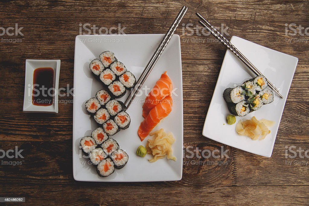 Sushi plates on the table stock photo