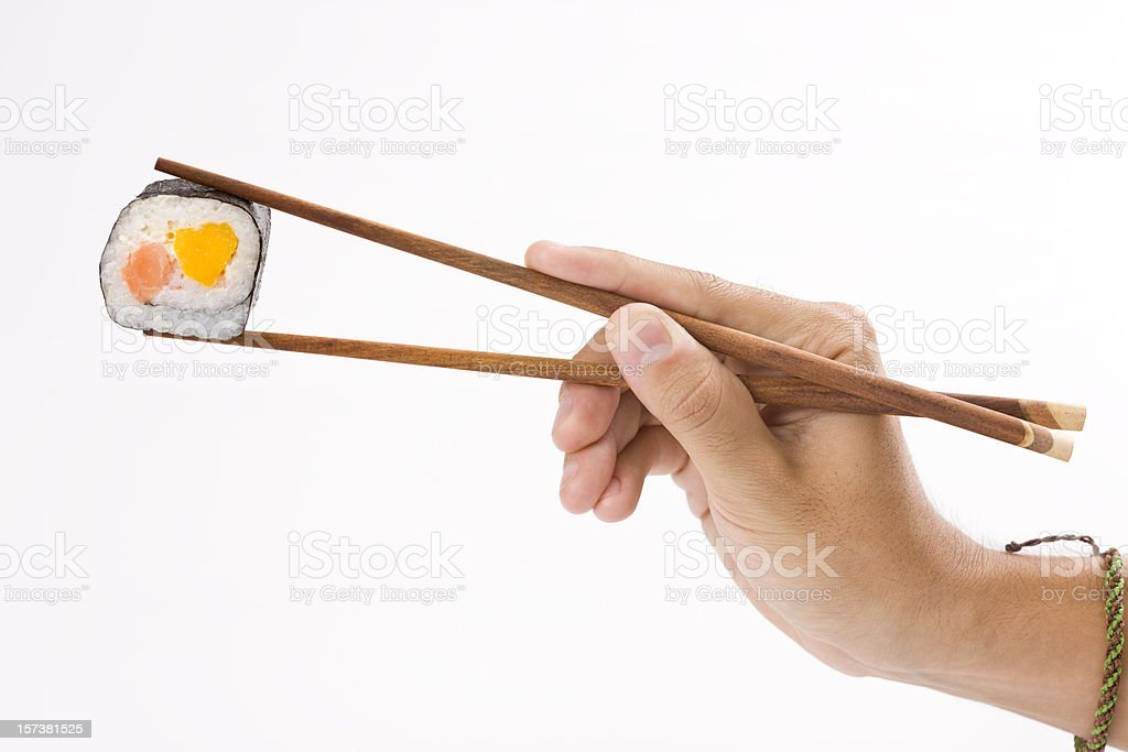 Sushi roll and chopsticks stock photo