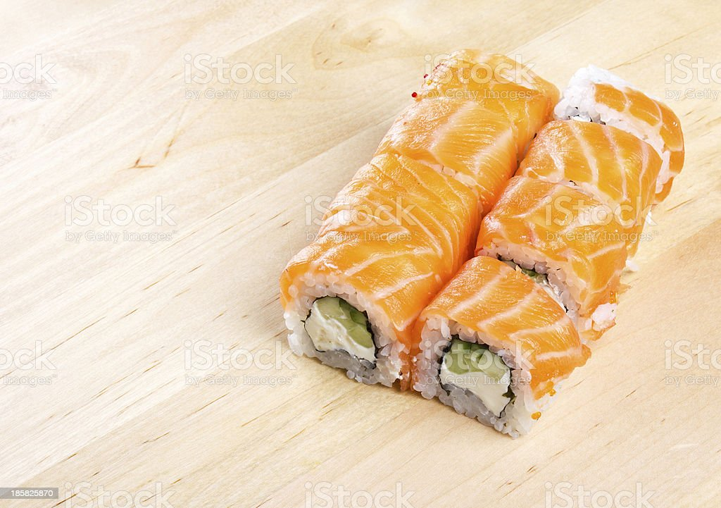 Sushi roll Philadelphia on wooden board royalty-free stock photo