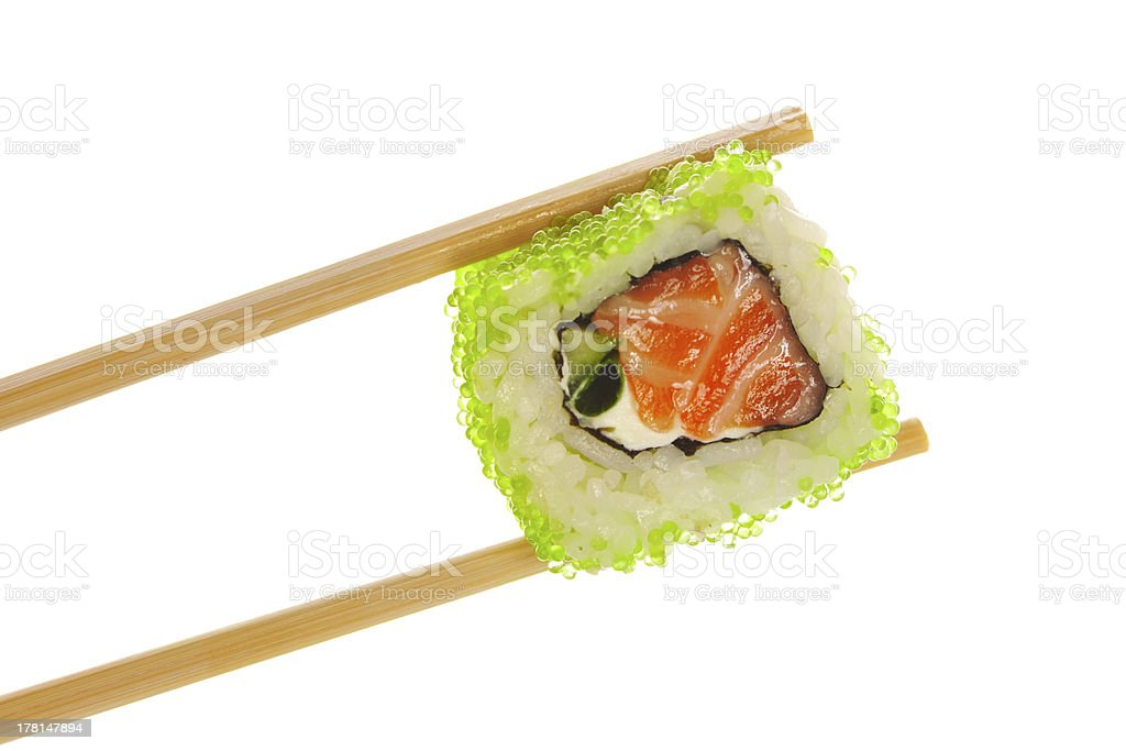 Sushi roll with chopsticks royalty-free stock photo