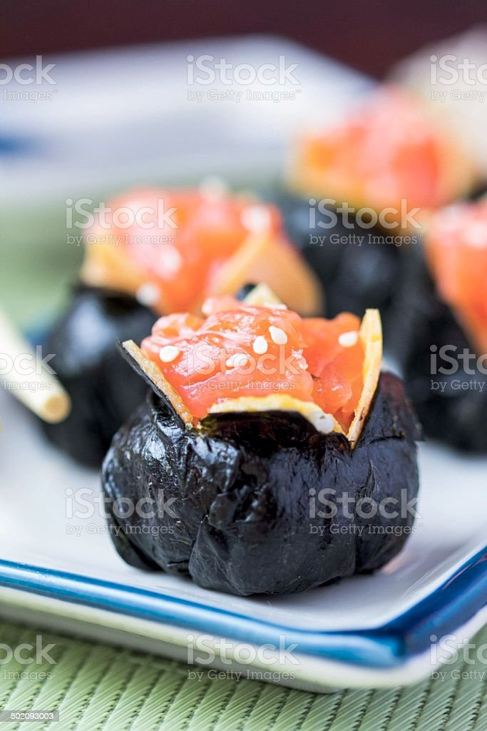 Sushi roll with rice, red fish, salmon, nori, beautiful ball royalty-free stock photo