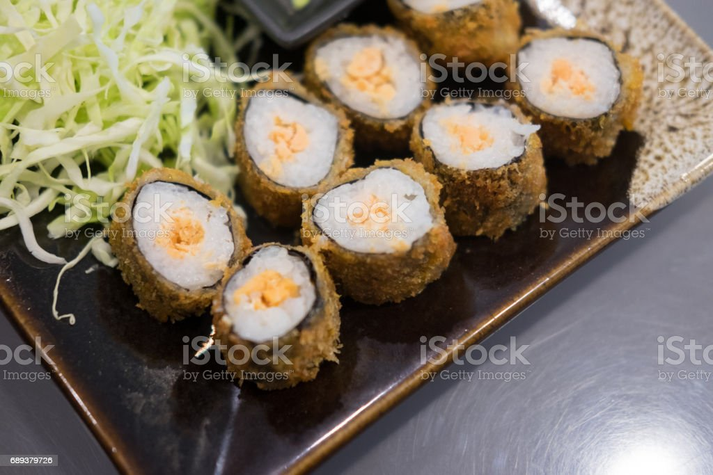 Sushi Roll with salmon in a beautiful plate. Sushi menu. Japanese food stock photo