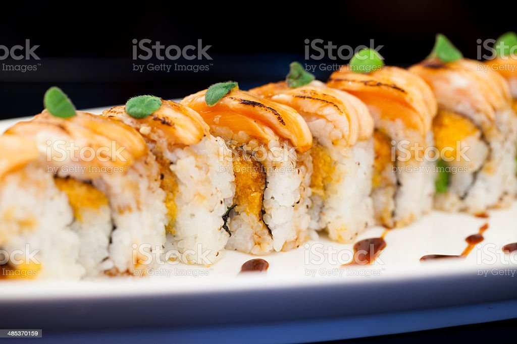 Sushi roll with salmon on plate stock photo