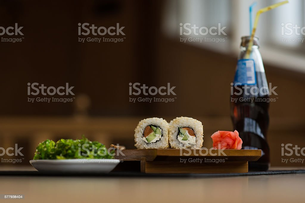 Sushi roll with sparkle drink and wakame salad stock photo