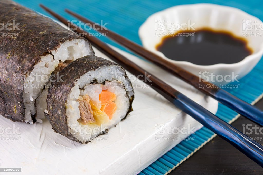 Sushi rolls and chopsticks stock photo