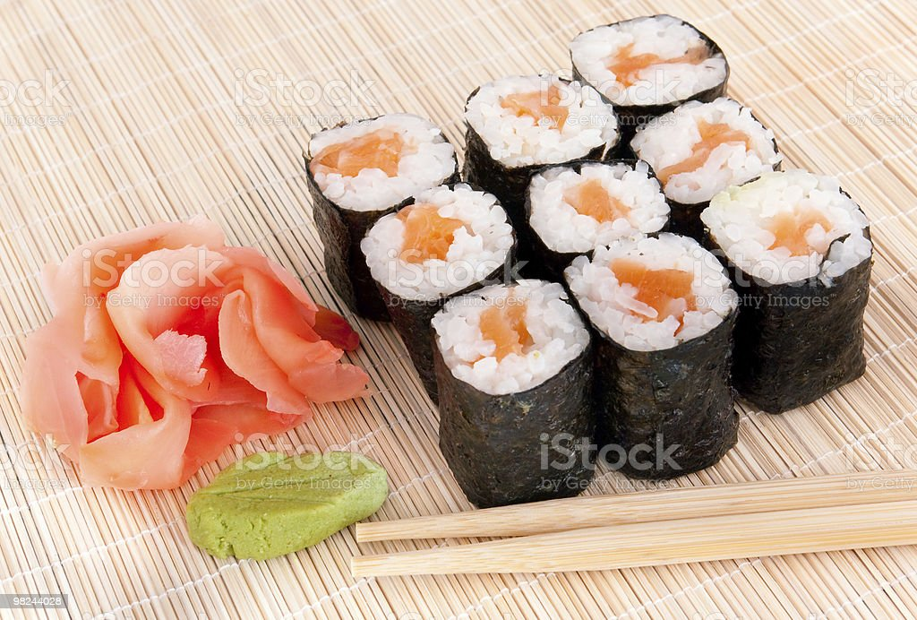 Sushi rolls on mat with chopsticks stock photo