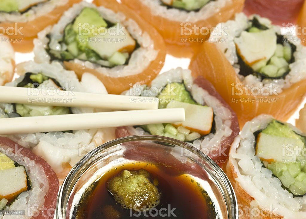 Sushi rolls, soy sauce, and chop sticks. stock photo