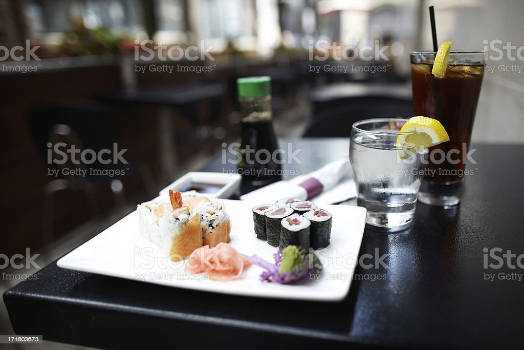 Sushi rolls varieties with drinks on table stock photo