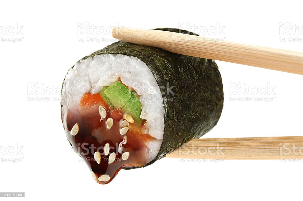 Sushi rolls with avocado, salmon and teriyaki sauce. Chopsticks. stock photo