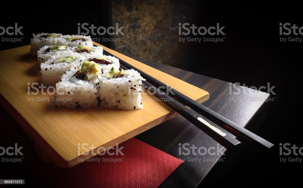 Sushi rolls with chopsticks stock photo