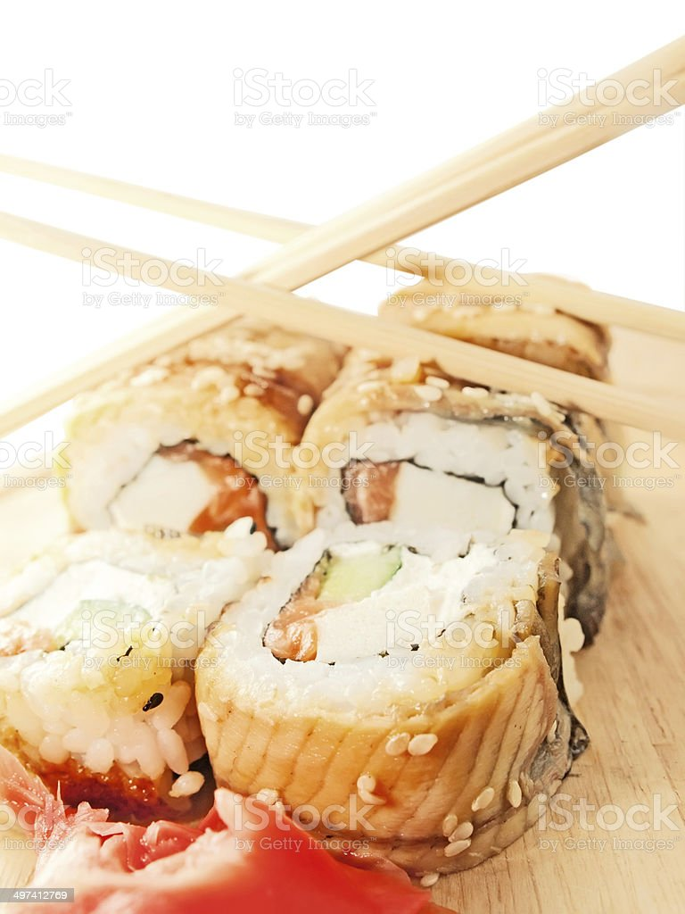 sushi rolls with omelette and eel and chopsticks on desk royalty-free stock photo