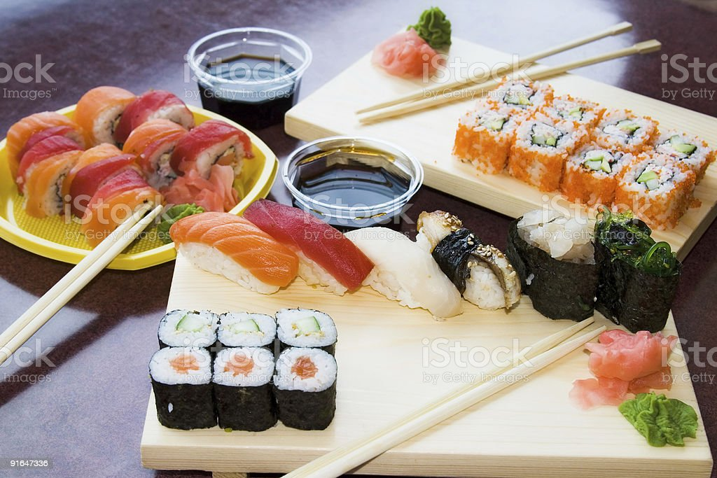 sushi rolls with sauce on plates royalty-free stock photo