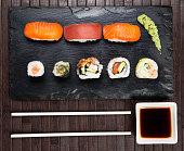 Sushi served on a slate plate
