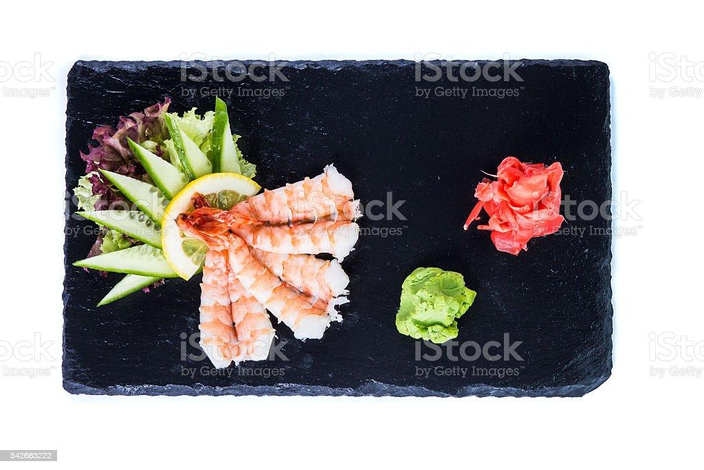 Sushi Set and sushi rolls on black stone slate. stock photo