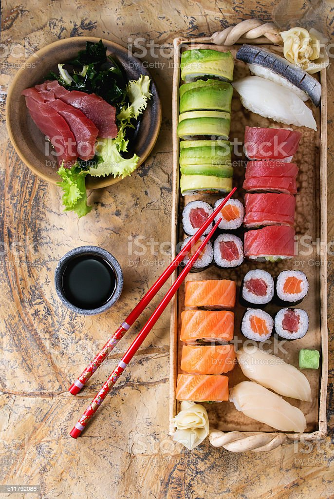 Sushi set nigiri, rolls and sashimi stock photo