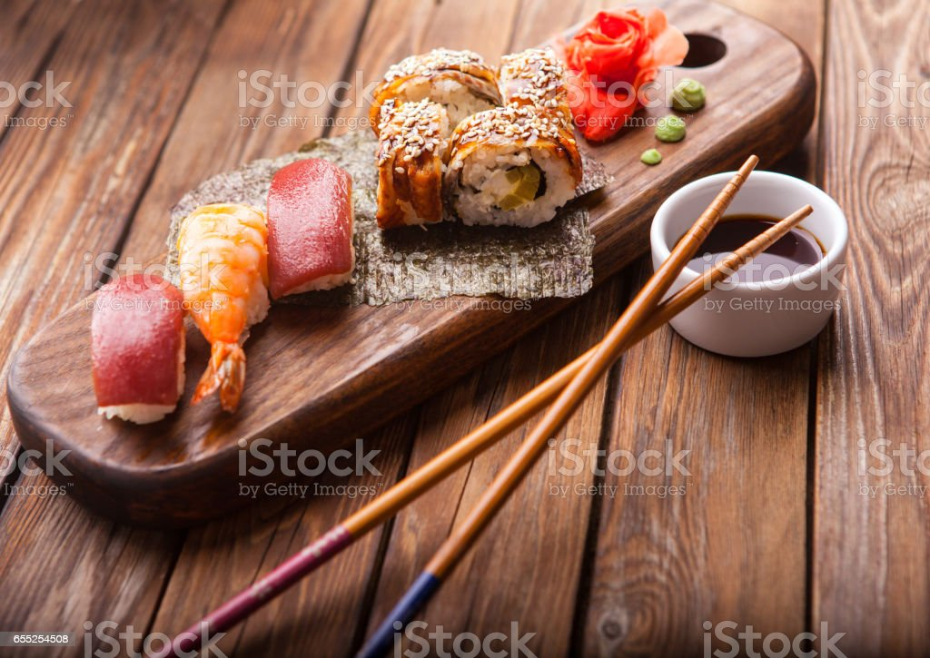 Sushi set on a wooden tray stock photo