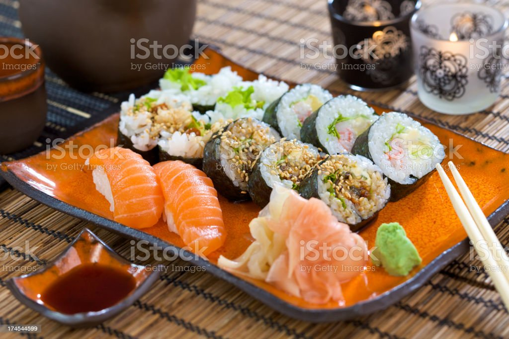 A sushi set with wasabi, soy sauce and chop stick royalty-free stock photo