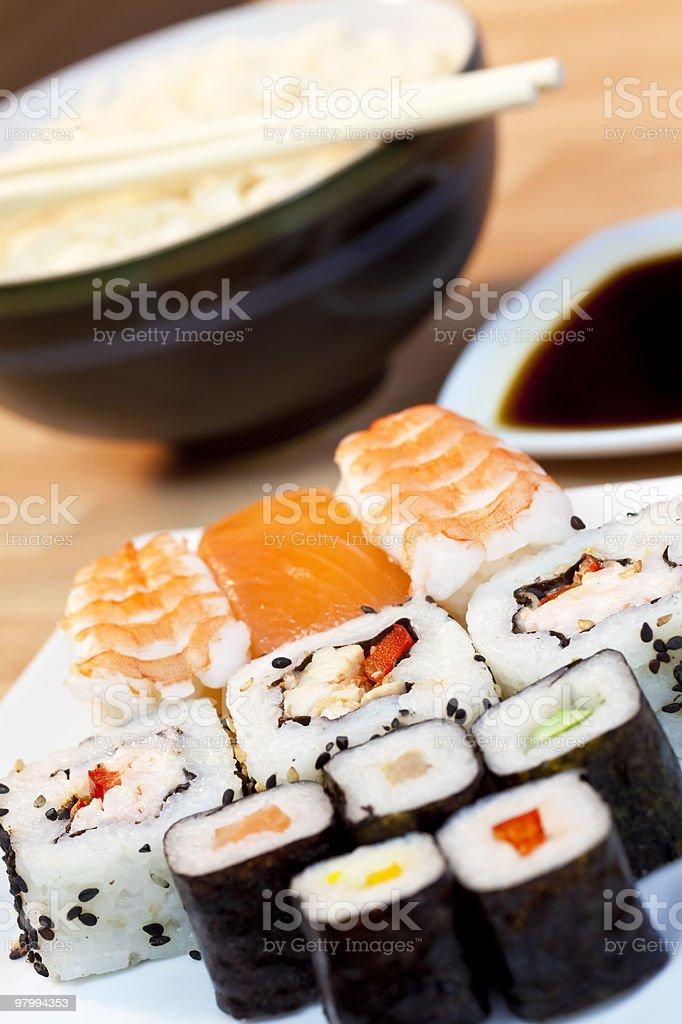 Sushi, Soy Sauce, Rice and Chopsticks royalty-free stock photo