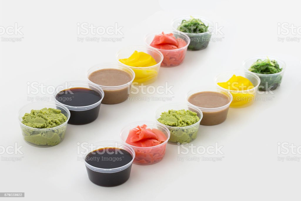 Sushi spices in small bowl isolated on white background stock photo