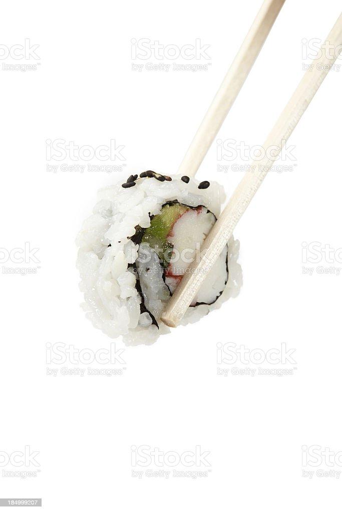 Sushi uramaki, inside out, california roll with chop sticks stock photo