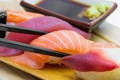 Sushi with chopsticks black, wasabi and shoyu sauce