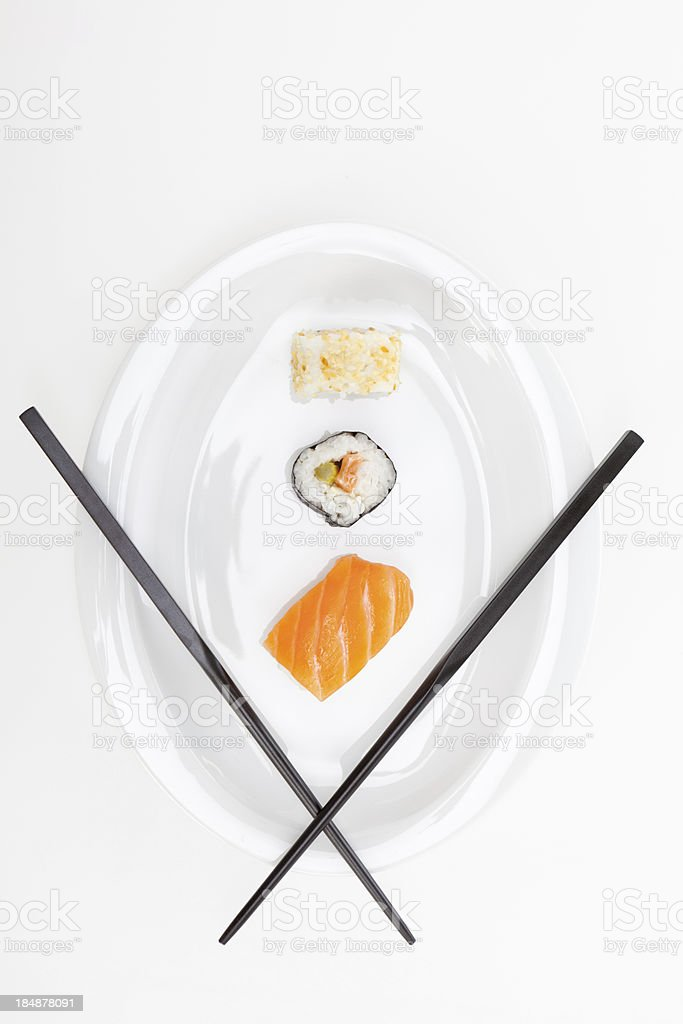 sushi with chopsticks on white plate stock photo