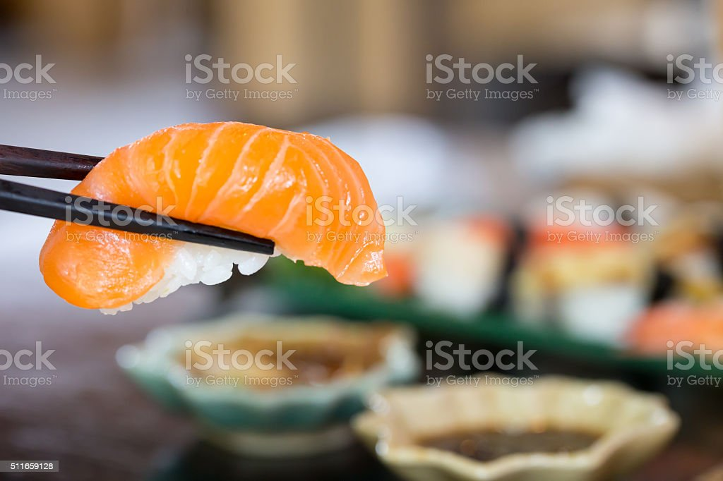 sushi with chopsticks stock photo