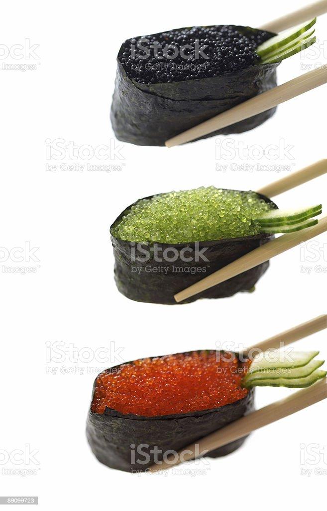 Sushi with chopsticks royalty-free stock photo