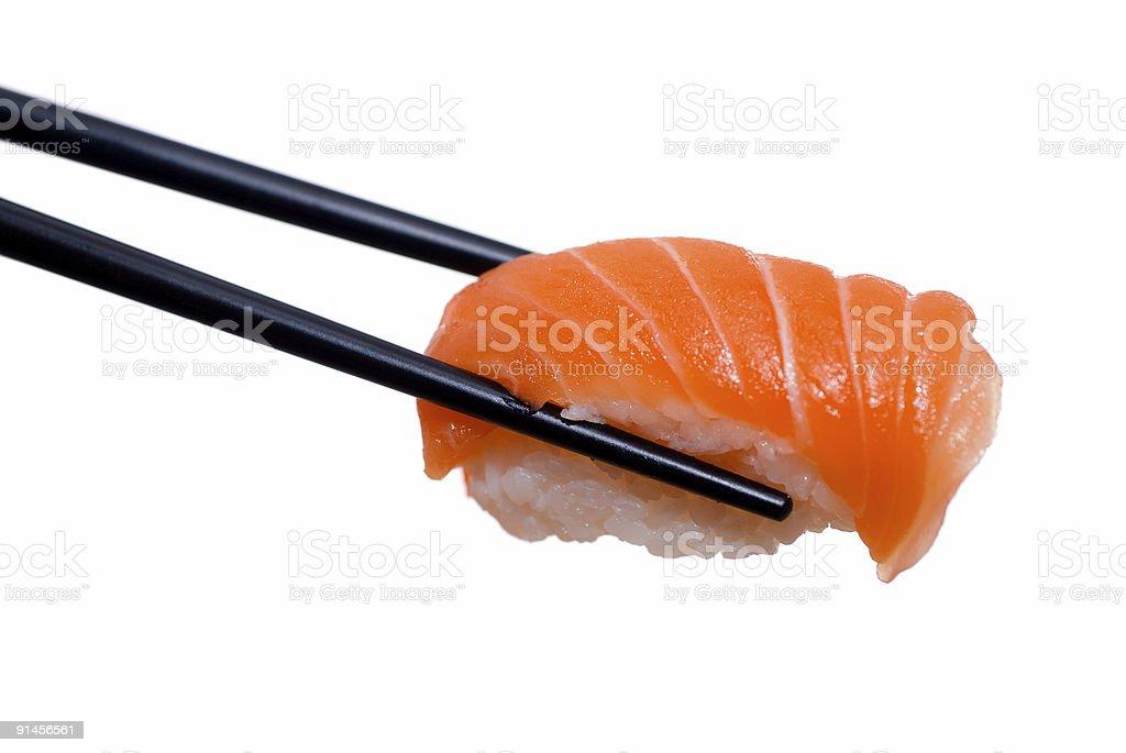 Sushi with chopsticks shot on white stock photo