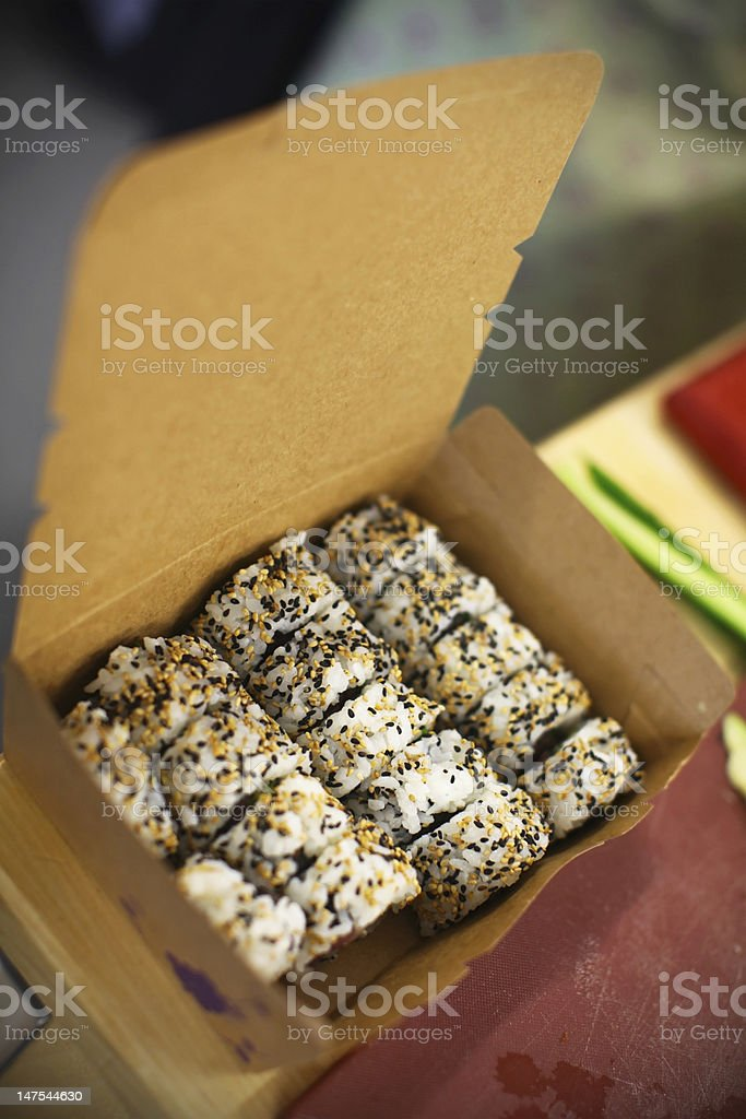 Sushi with sesame in the box royalty-free stock photo