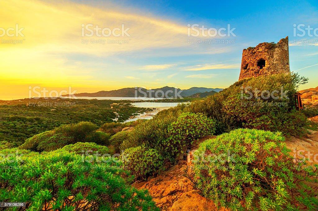 Susnet over old tower of Villasimius, Sardinia stock photo