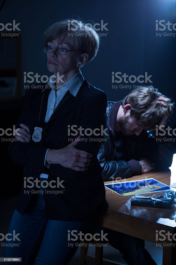 Suspect man looking at picture stock photo