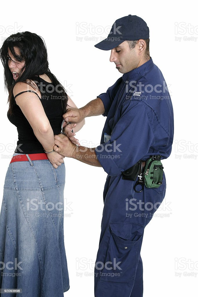 Suspect thief being handcuffed royalty-free stock photo