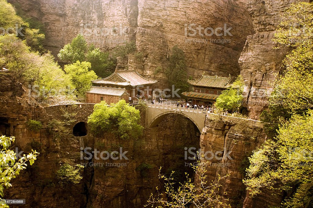 suspended bridge and temple in Hebei province, China royalty-free stock photo