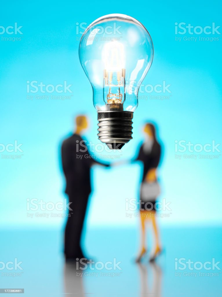 Suspended Electric Light Bulb with Business People royalty-free stock photo