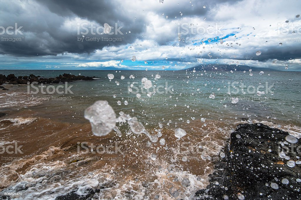 Suspended Ocean Wave Droplets during Storm stock photo