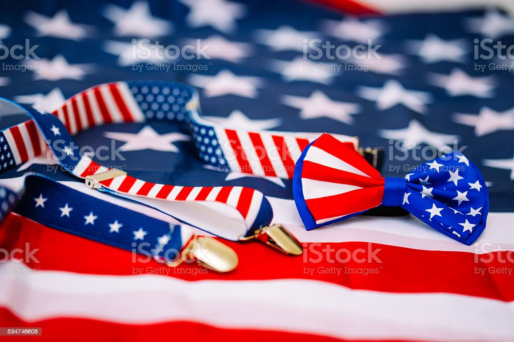 Suspenders and tie on flag stock photo