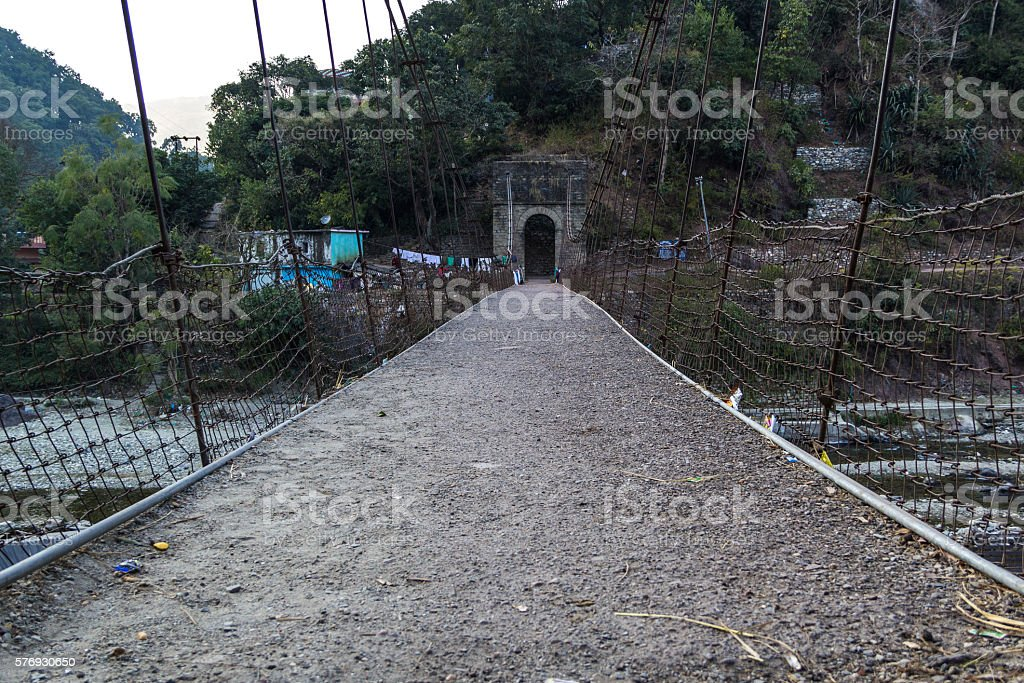 Suspension bridge across a river stock photo