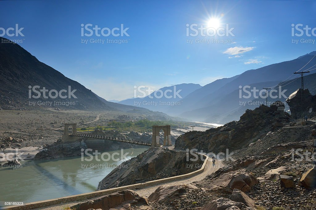 Suspension bridge across the Indus River along the Karakorum Highway stock photo