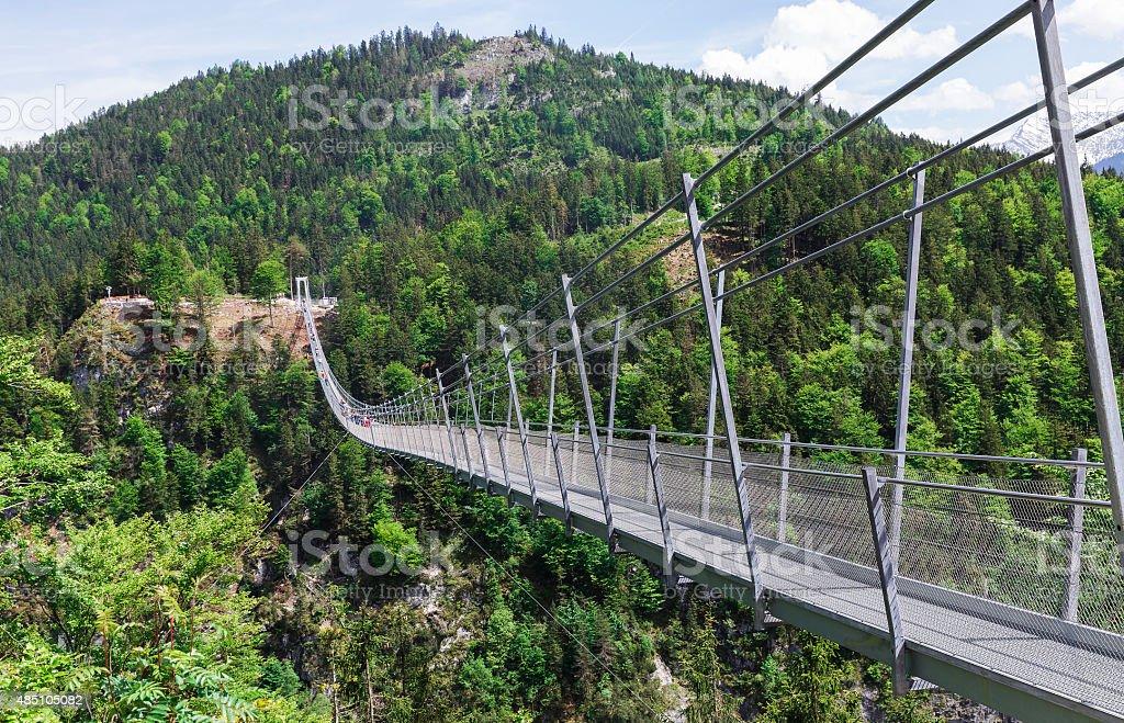 suspension bridge and castle stock photo