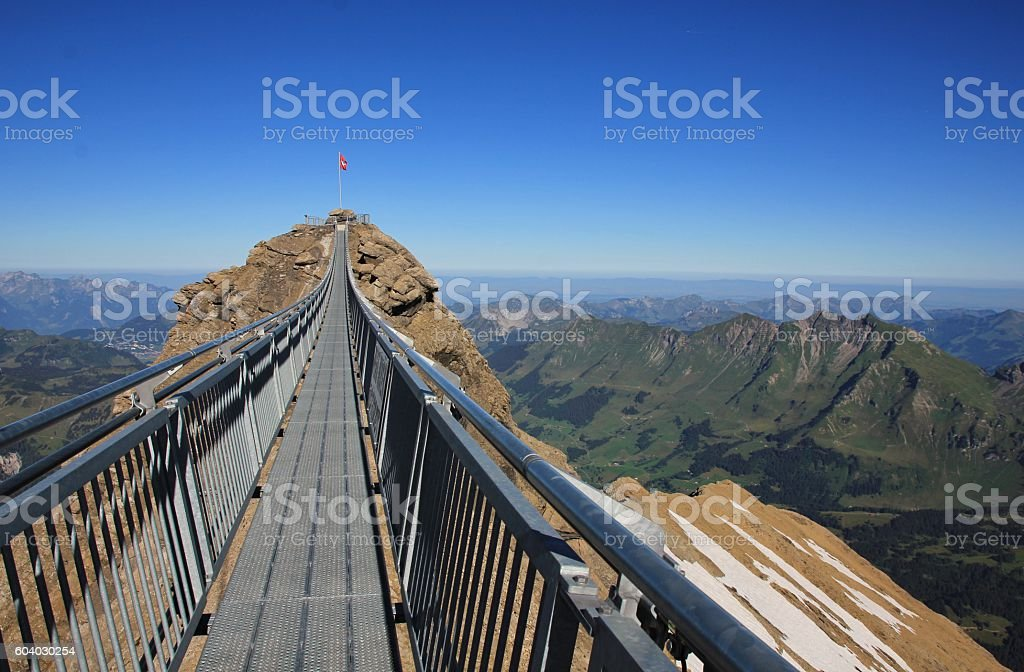 Suspension bridge connecting two peaks in the Alps stock photo