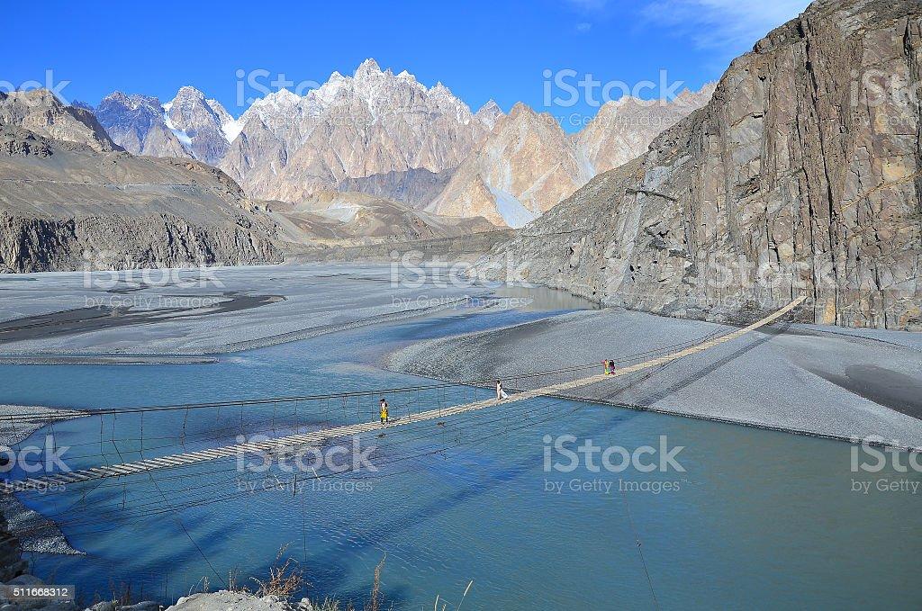 Suspension bridge in northern Pakistan stock photo